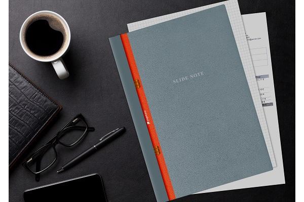 リングレスの「スライド式ルーズリーフ」誕生!穴のない資料もファイリングでき、1つのノートとして一括管理